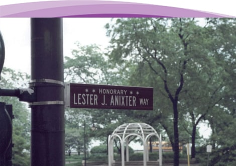 great photo of the Lester J Anixter street sign with a beautiful park background