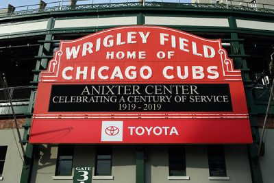 Anixter Center Celebrating a Century of Service on the Cubs marquis