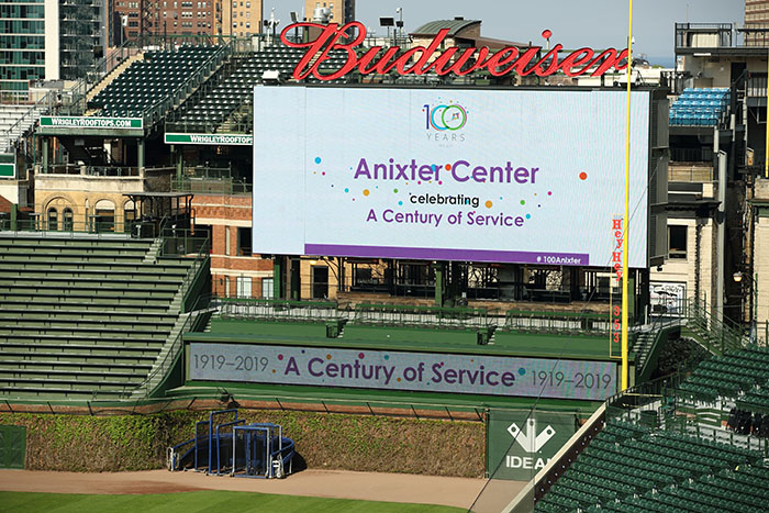 Anixter Center Celebrating a Century of Service on the Cubs billboard