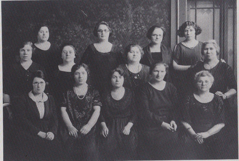 black and white photo of the original 13 female founders