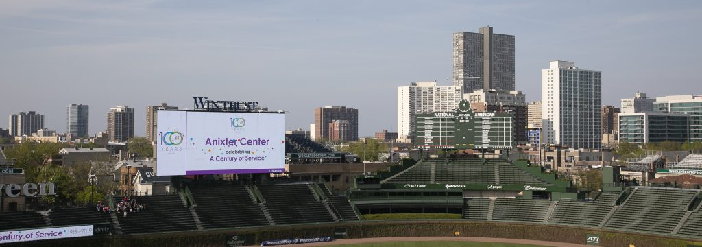 Anixter Center celebrating A Century of Service builboard at Wrigley Field