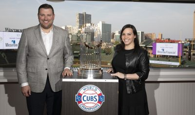 man and woman with world series trophy