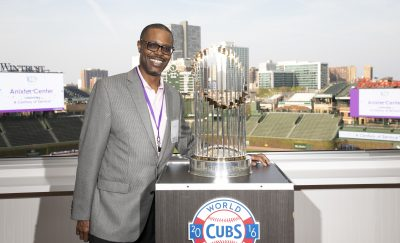 man with world series trophy