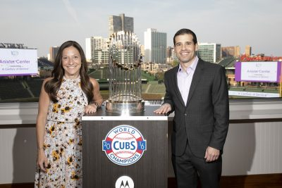 man and women with the world series trophy