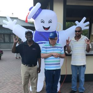 anixter center clients posing with the stay puft character