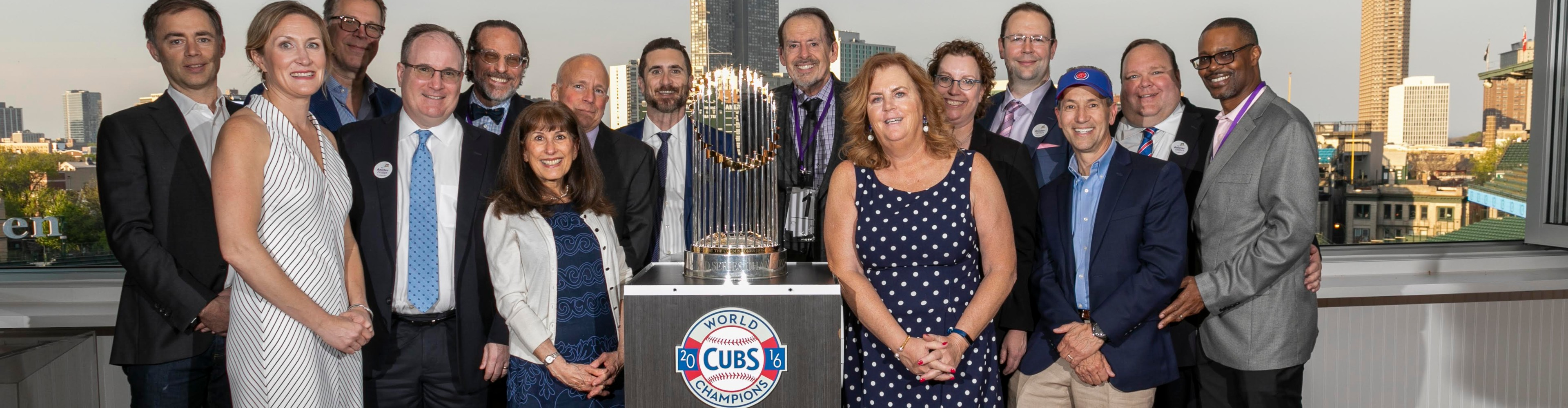 Anixter Board of Directors posing with the World Series Trophy