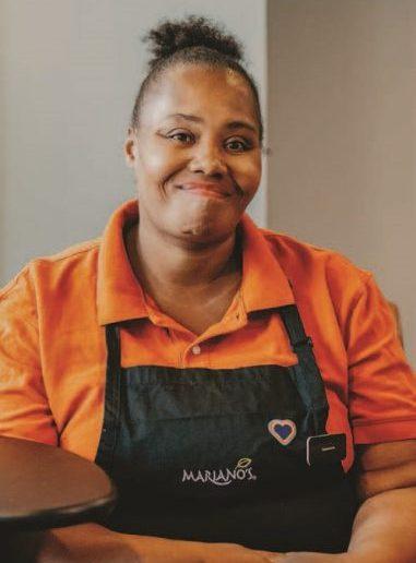 Female CMH client smiling