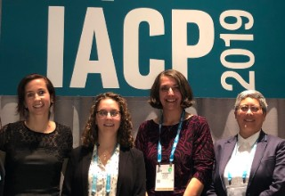 Christine Jensen, Director of Training, posing with fellow panelist at the IACP 2019 conference.