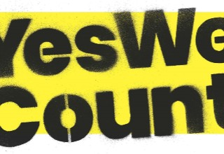 #YesWeCount (black bold letters on a yellow background)