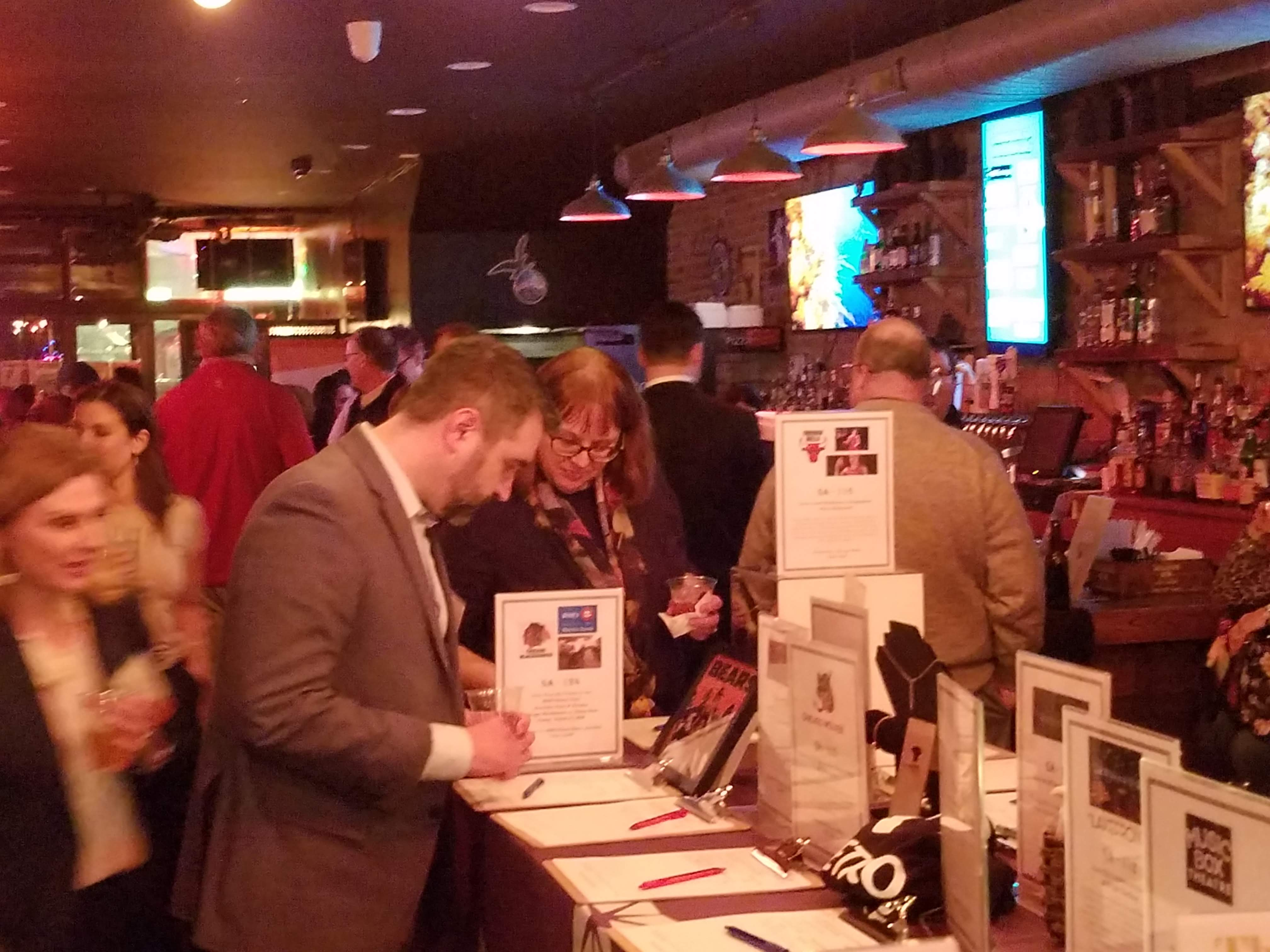 Guests at the 2020 Winter Warm Up bidding on the silent auction items.