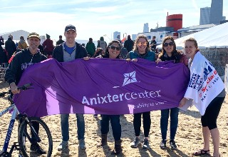 Rebecca Clark, Anixter Center President/CEO, with Anixter Staff celebrating her plunge into the icy waters of Lake Michigan for the Polar Plunge supporting Special Olympics Chicago.